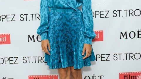 Is Eva Mendes Done Showing Her Bod? Covers Up In Blue Azzaro | StyleCaster