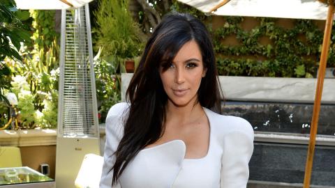 Kim Kardashian Defends Maternity Style, Says Flat Shoes Hurt Her Back | StyleCaster