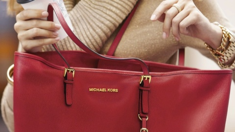 Michael Kors is Suing Costco For Claiming They Sell His Bags   StyleCaster