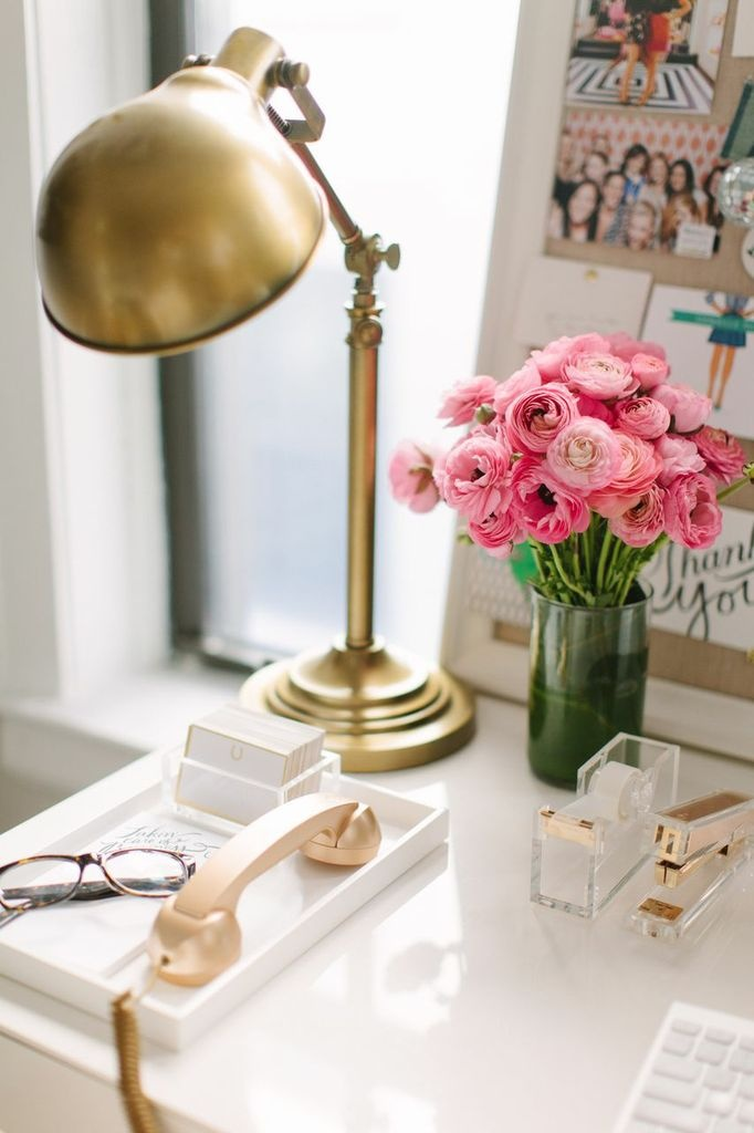 chic workspace ideas with flowers on a desk.