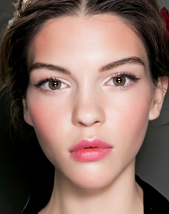 girl flushed cheeks clear skin