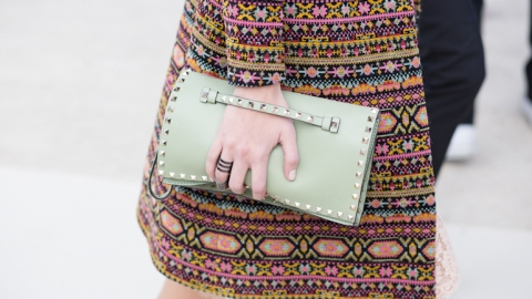 The New Way to Carry a Clutch   StyleCaster