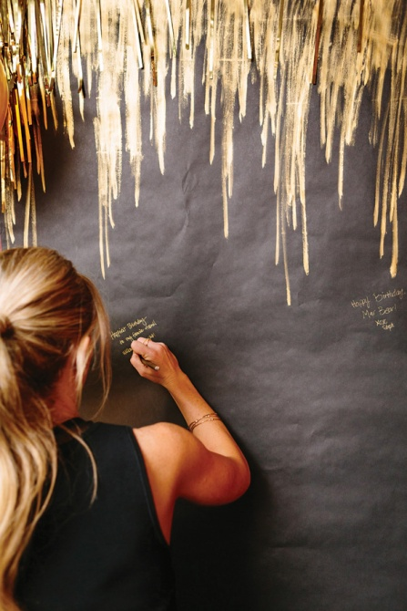 gold pen guestbook wall 27 Stylish Birthday Party Ideas for Adults
