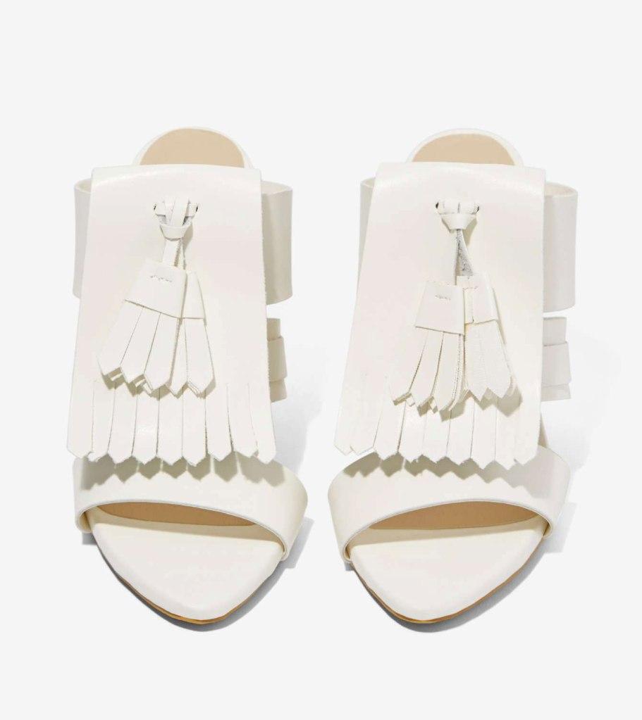 white fringe mules