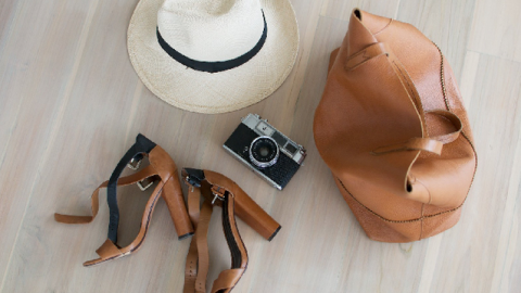 The Genius Way to Pack a Hat  | StyleCaster