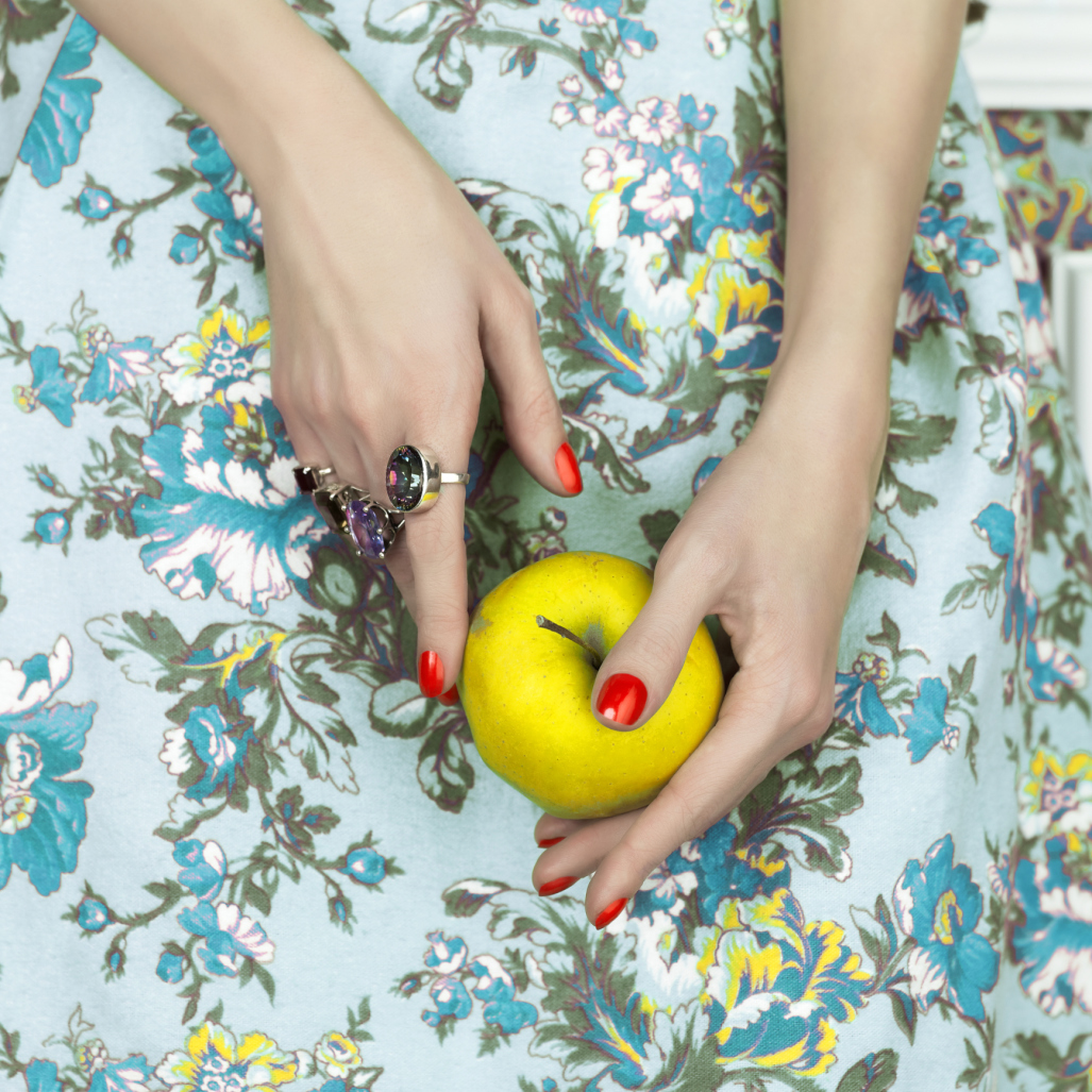Woman's hands with apple