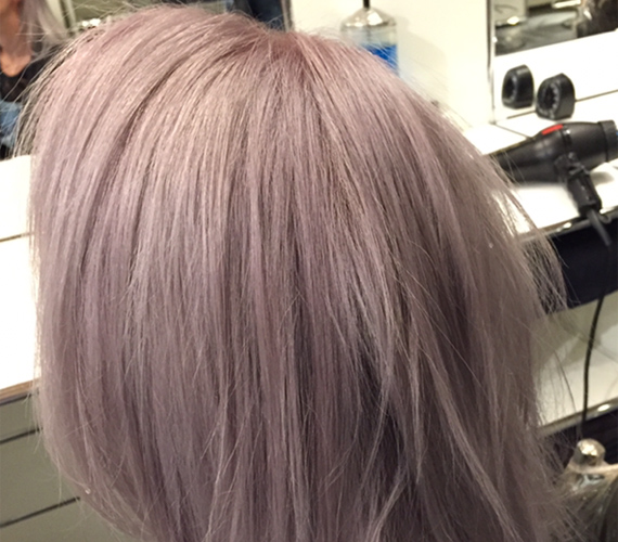 A gorgeous lavender/gray fade sitting in the salon chair.