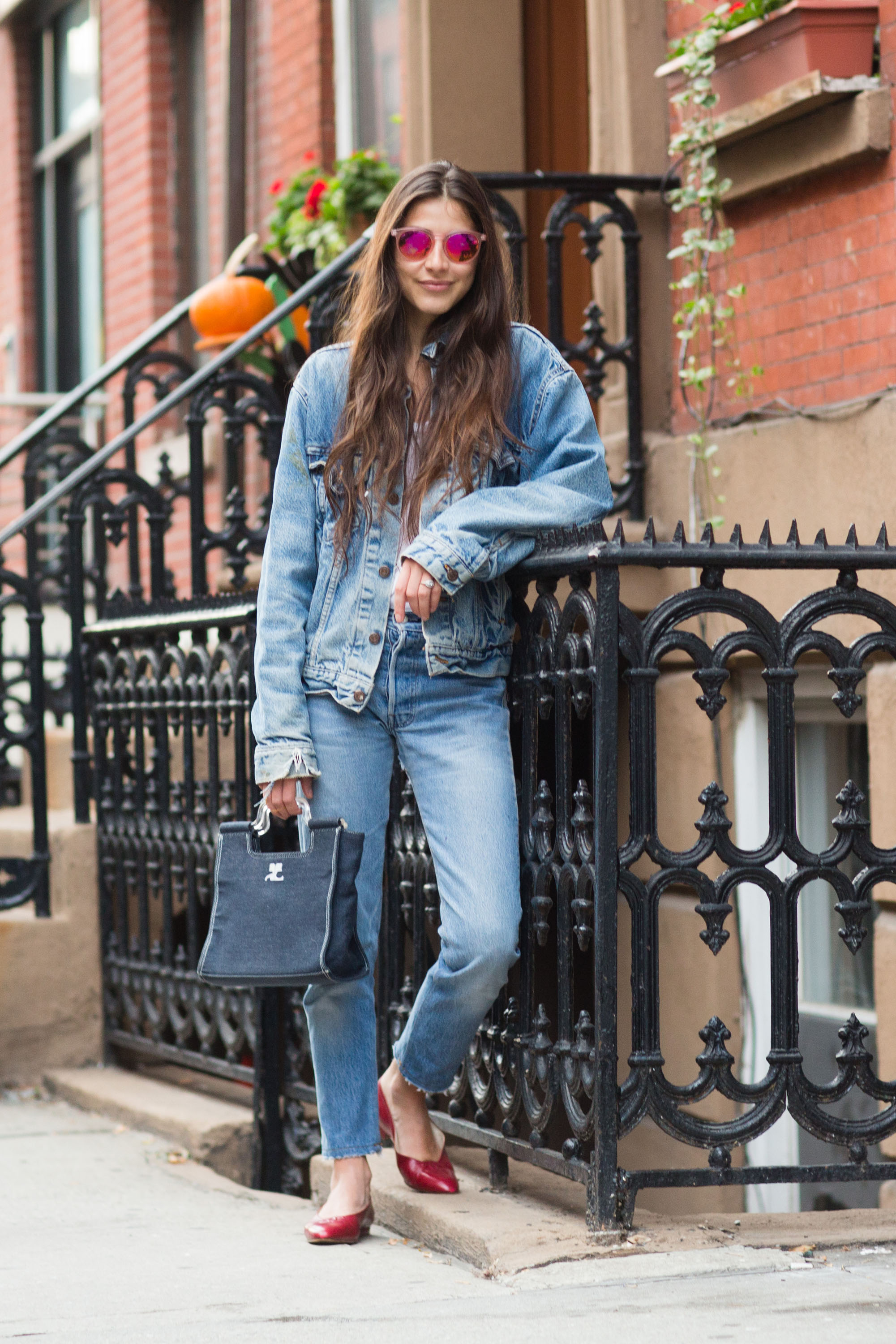 NEW YORK, NY - NOVEMBER 23: Writer and founder of Definer app Felicity Sargent wears a vintage Levi's denim jacket, Club Monaco t-shirt, vintage Redun jeans, Chanel flats, and Courrges bag in Chelsea on November 23, 2014 in New York City. (Photo by Melodie Jeng/Getty Images)