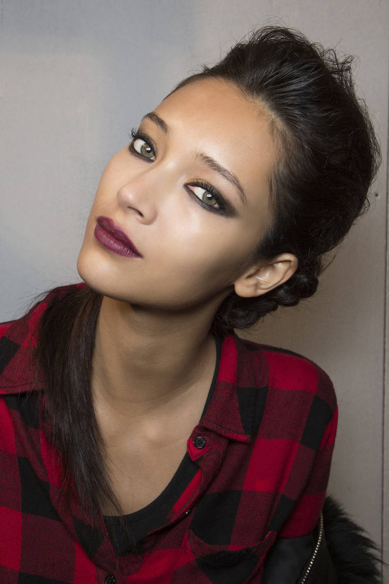model with berry lipstick