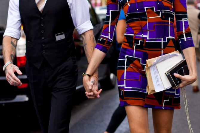 couple holding hands street style