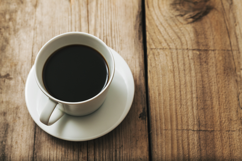 Black Coffee Cup On Rustic Wooden Surface