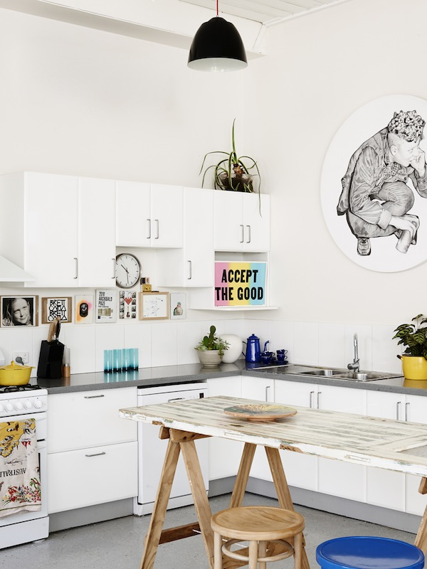 Make a small room look bigger with expansive counter tops in the kitchen