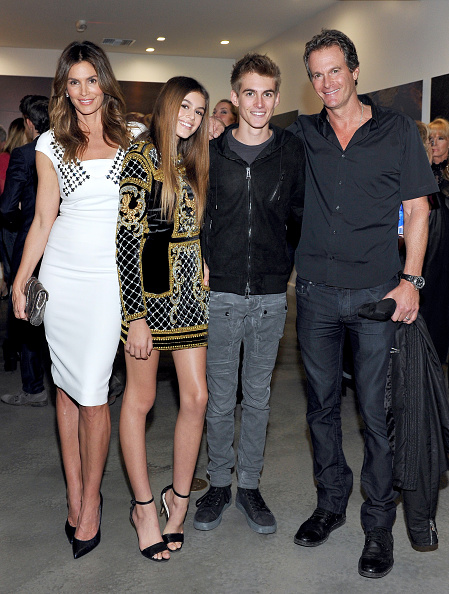 "WEST HOLLYWOOD, CA - DECEMBER 04: (L-R) Cindy Crawford, model Kaia Jordan Gerber, Presley Walker Gerber, and businessman Rande Gerber attend a book party in honor of ""Becoming"" by Cindy Crawford, hosted by Bill Guthy And Greg Renker, at Eric Buterbaugh Floral on December 4, 2015 in West Hollywood, California. (Photo by Donato Sardella/WireImage)"