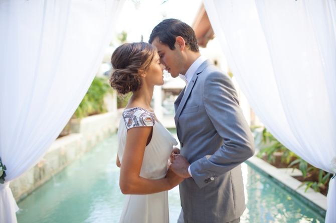 bride and groom kissing Wedding Gift Etiquette: How Much Money to Give & Other Pressing Questions