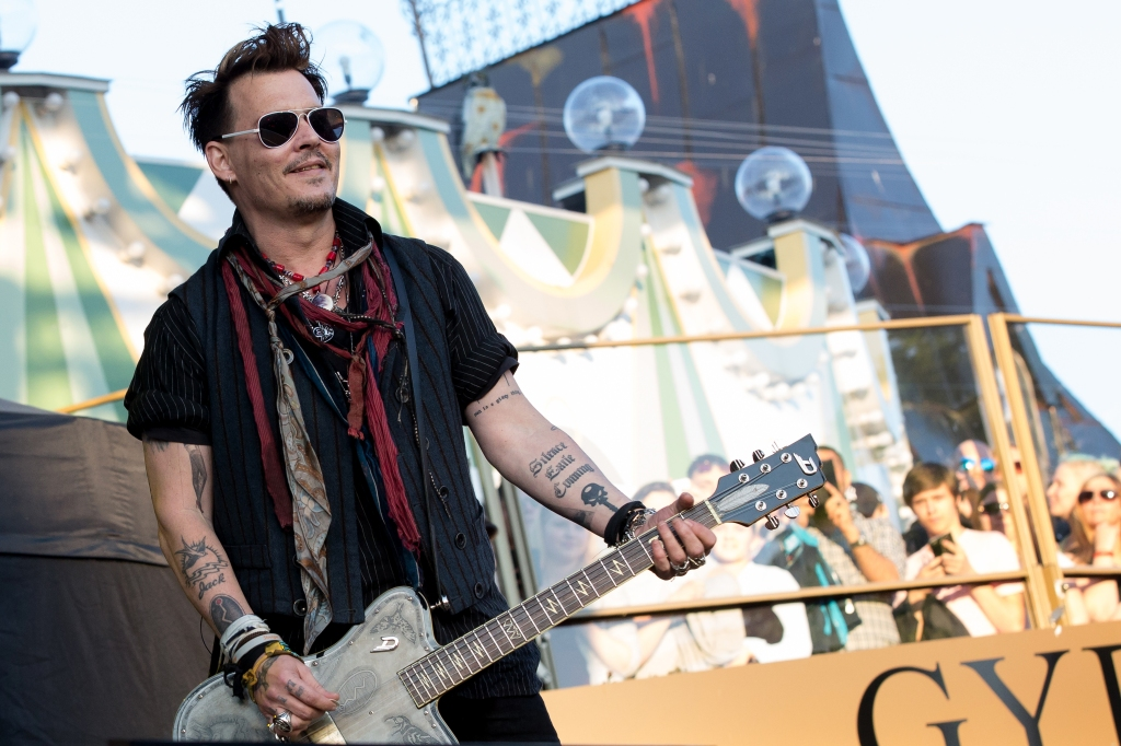 Johnny Depp Changes Tattoo Of Amber Heard S Nickname From Slim To Scum Stylecaster