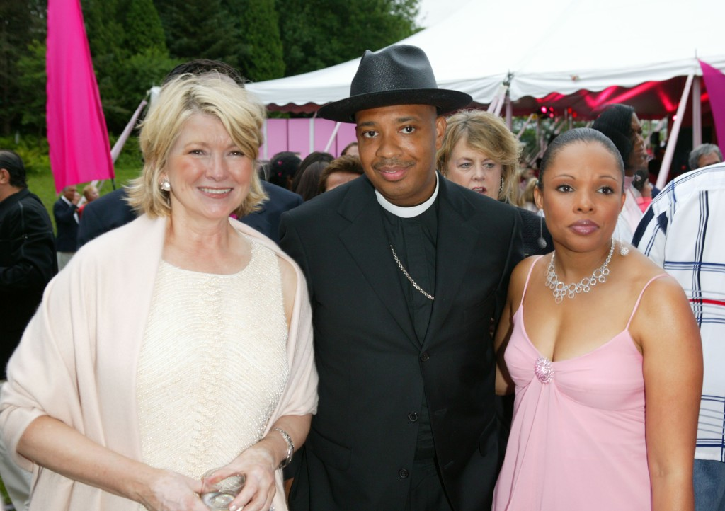 EAST HAMPTON - JULY 24: Martha Stewart (L) and rap music star Reverend Run (C) pose together at the 5th Annual Art For Life Benefit at the home of Russell Simmons July 24, 2004 in East Hampton, New York. (Photo by Matthew Peyton/Getty Images)