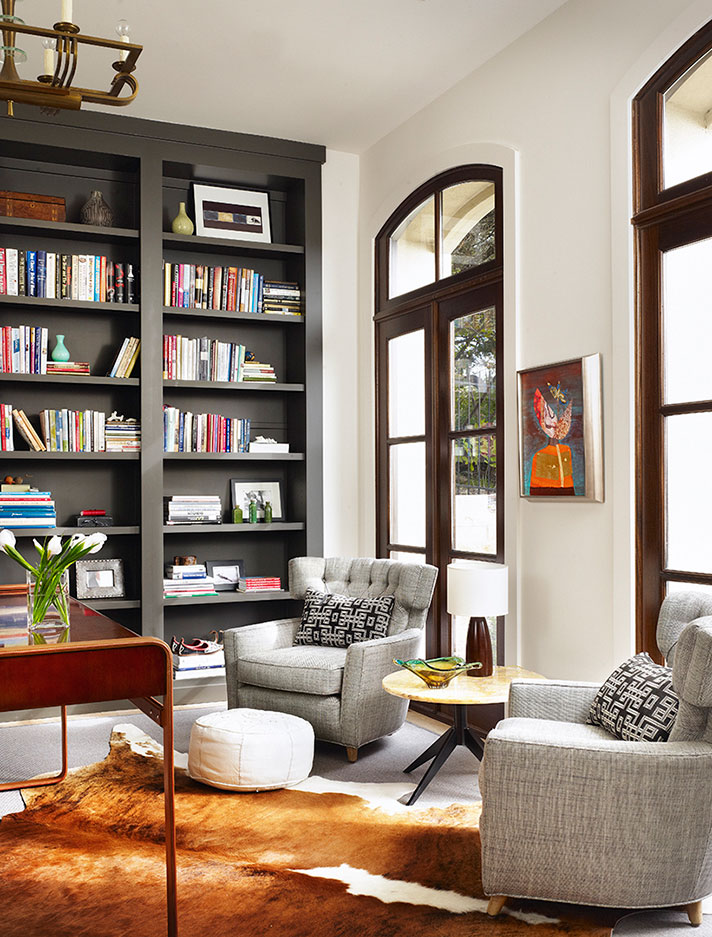 make a living room feel bigger and taller with floor-to-ceiling bookshelves