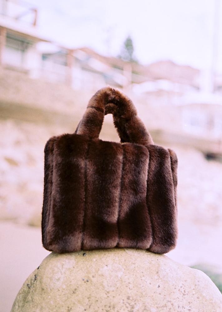 The Deneuve Bag, $150.50 (was $215); at Staud https://staud.clothing/product/2574