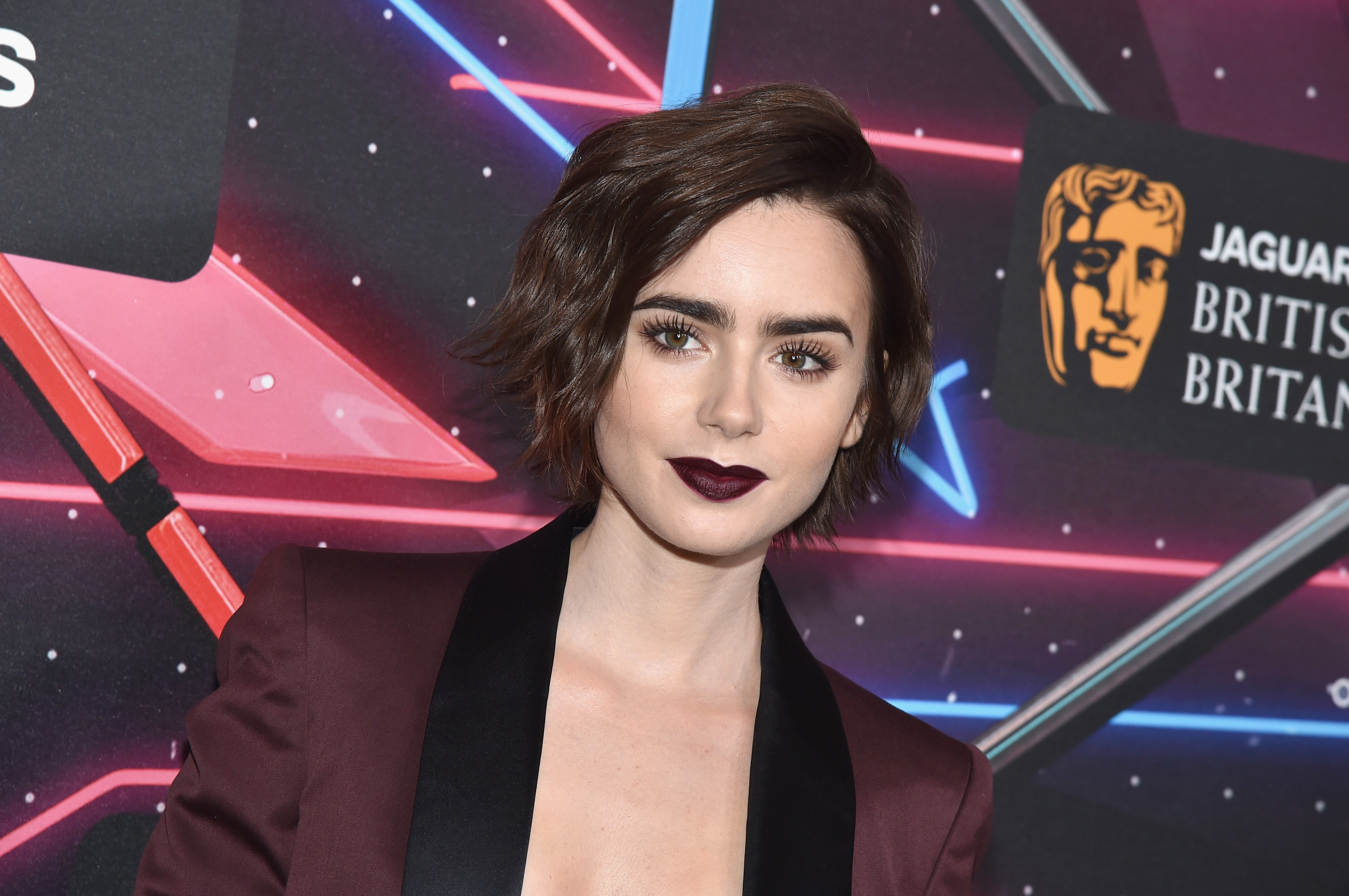 Red Alert: Lily Collins Debuts Bomb Blunt Bangs
