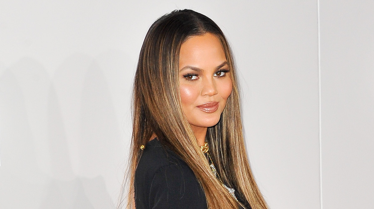 Here's Chrissy Teigen Eating Fries While Working Out Half Naked