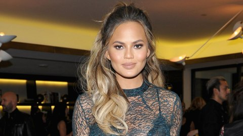 Why Is Chrissy Teigen Curled Up Naked on This Chair? | StyleCaster