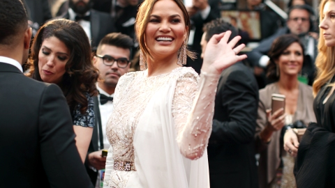 Chrissy Teigen Suffers from Yet Another Wardrobe Malfunction at the Oscars | StyleCaster