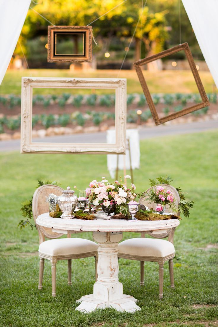 whimsical frames diy photo booth 30 Creative Outdoor Entertaining Ideas for the Ultimate Soirée