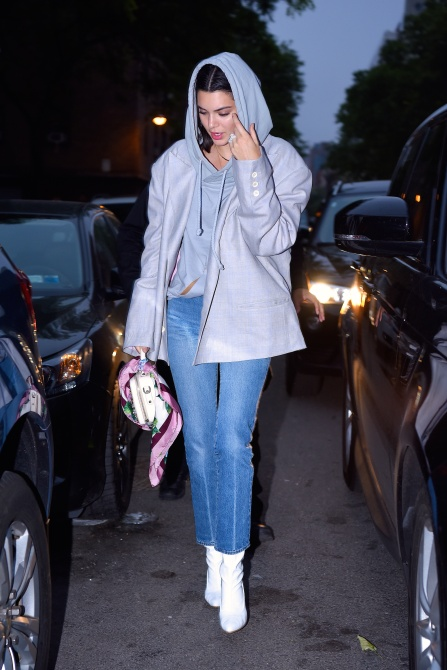 Kendall Jenner Style: Kendall wears an oversized gray coat over a hoodie and simple blue jeans in New York City.