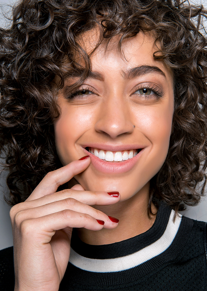 brown curly hair The Expert Approved Way to Use Your Hair Diffuser for Camera Ready Curls