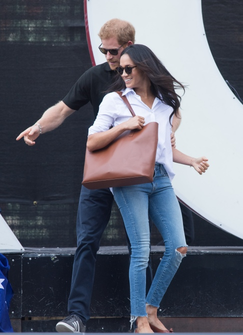 meghan markle prince harry 2017 Meghan Markle Shamed for Wearing Ripped Jeans on Date with Prince Harry