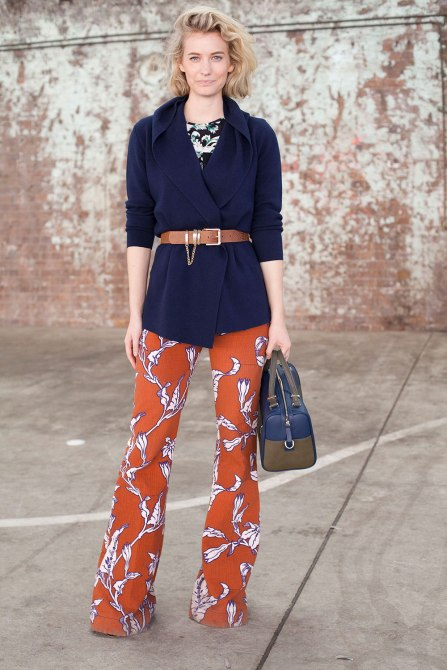STYLECASTER | How to Wear Clashing Colors | Navy Coat with Orange Floral Printed Pants