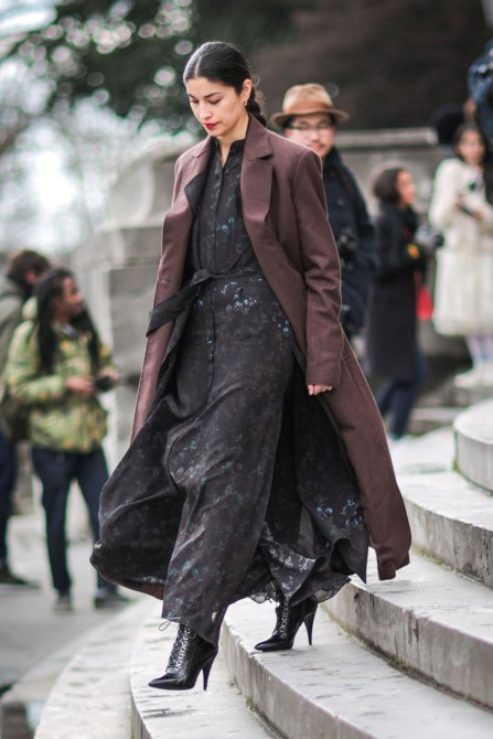 STYLECASTER | How to Wear Clashing Colors | Black Dress with Brown Long Coat