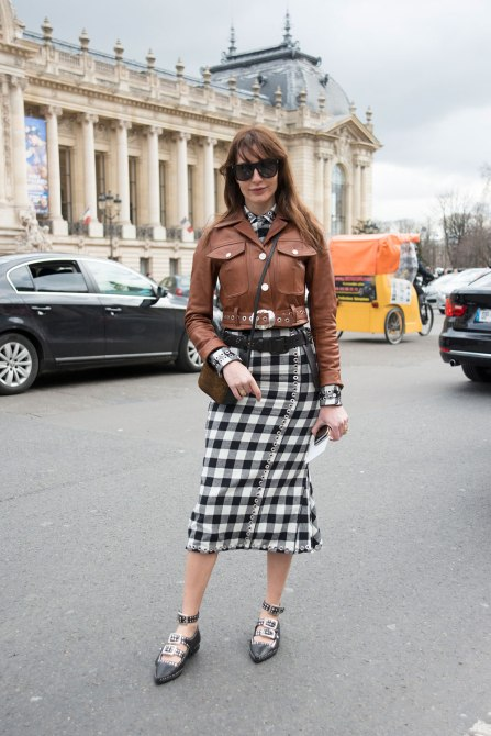STYLECASTER | How to Wear Clashing Colors | Brown Leather Jacket and Black Picnic Print Dress