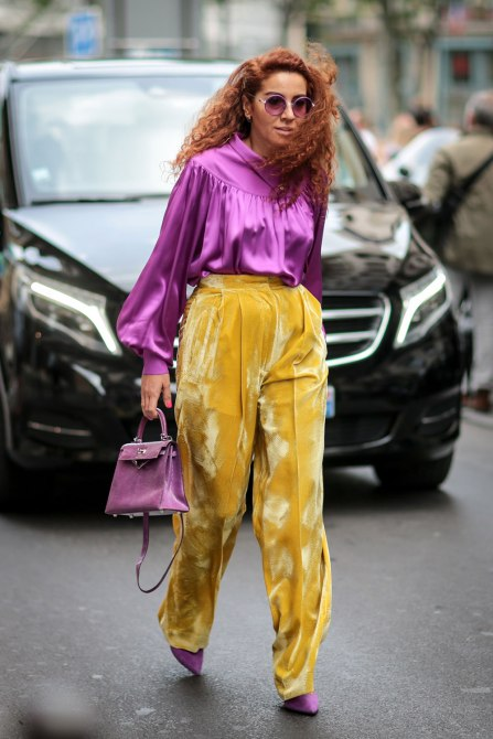 STYLECASTER | How to Wear Clashing Colors | Purple Silk Blouse and Yellow Velvet Pants