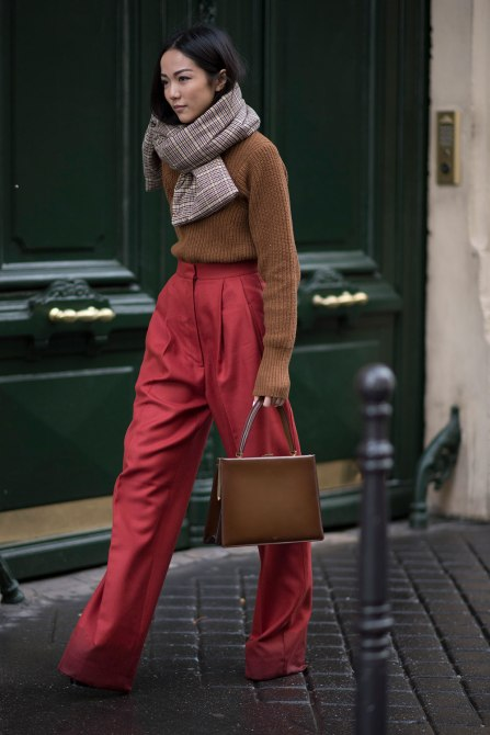 STYLECASTER | How to Wear Clashing Colors | Brown Sweater with Red Bell Bottom Trousers
