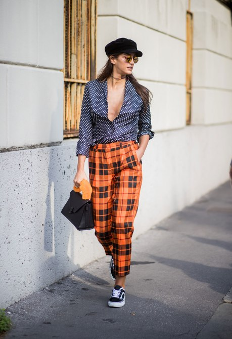 STYLECASTER | How to Wear Clashing Colors | Blue Button Down with White Polka Dots and Orange Plaid Pants