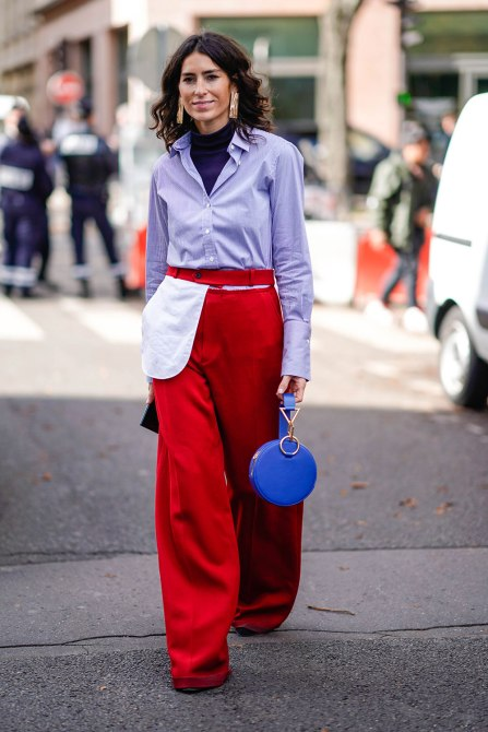 STYLECASTER | How to Wear Clashing Colors | Blue Button Down and Red Bell Bottom Pants