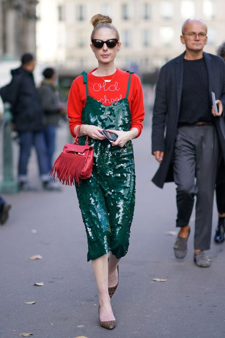STYLECASTER | How to Wear Clashing Colors | Red Sweatshirt with Green Sequin Dress Over Top