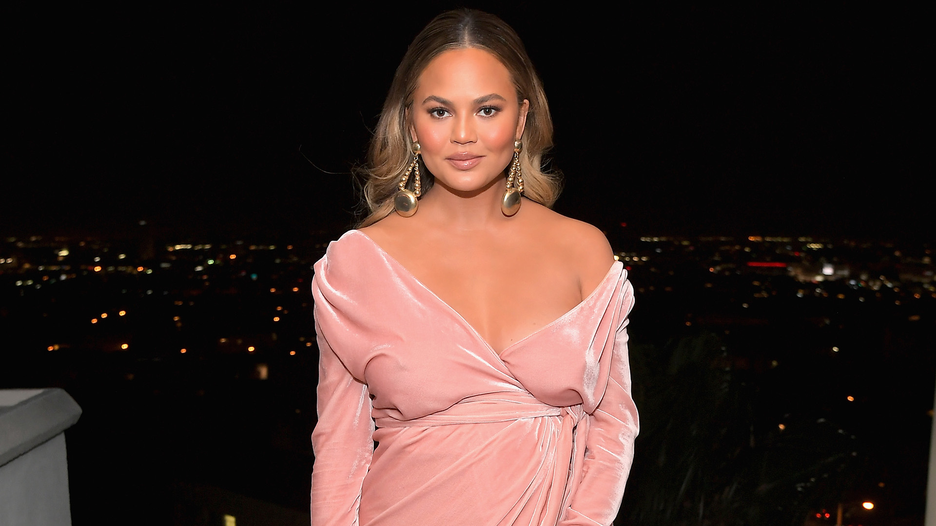 Chrissy Teigen Proudly Shows Off Lopsided Boobs from One-Sided Breastfeeding