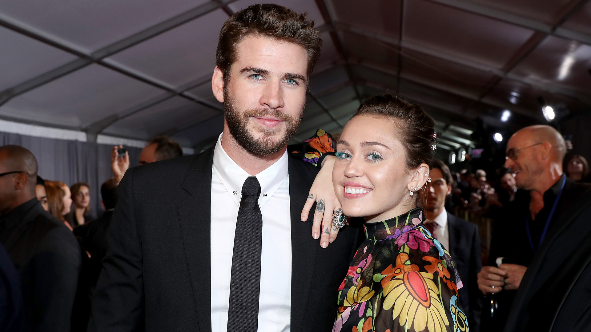 Miley Cyrus and Liam Hemsworth Debuted Matching Food-Related Tattoos
