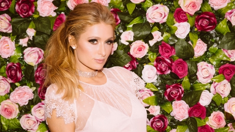 Paris Hilton Modeling a Sequin Dress in a Laundromat Is the Funniest Thing We've Ever Seen | StyleCaster