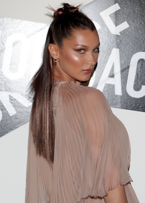 half up half down bella hadid 1 Trend Alert: Celebs Cant Stop Wearing the Half Up, Half Down Hairstyle