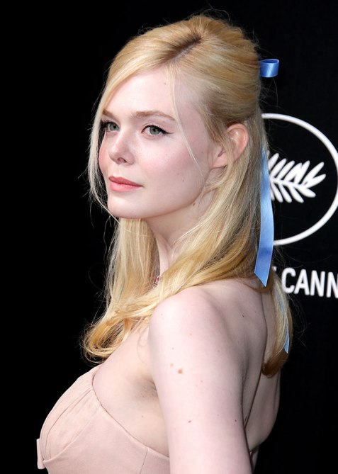 half up half down elle fanning Trend Alert: Celebs Cant Stop Wearing the Half Up, Half Down Hairstyle