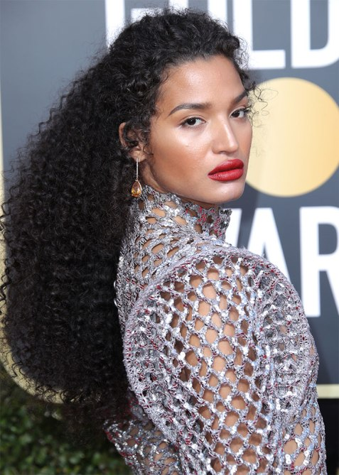 half up half down indya moore Trend Alert: Celebs Cant Stop Wearing the Half Up, Half Down Hairstyle