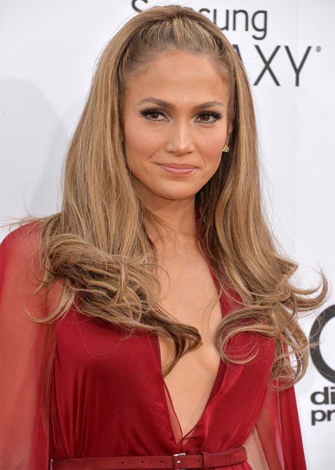 half up half down jennifer lopez 1 Trend Alert: Celebs Cant Stop Wearing the Half Up, Half Down Hairstyle