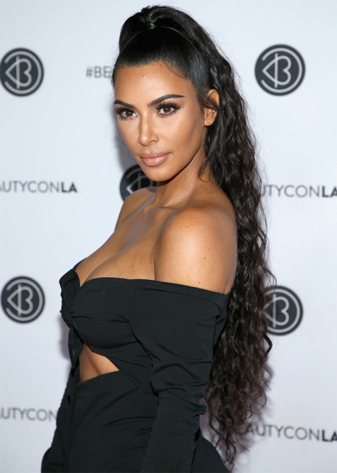 half up half down kim k 1 Trend Alert: Celebs Cant Stop Wearing the Half Up, Half Down Hairstyle