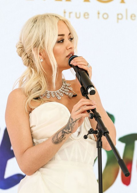 half up half down rita ora Trend Alert: Celebs Cant Stop Wearing the Half Up, Half Down Hairstyle
