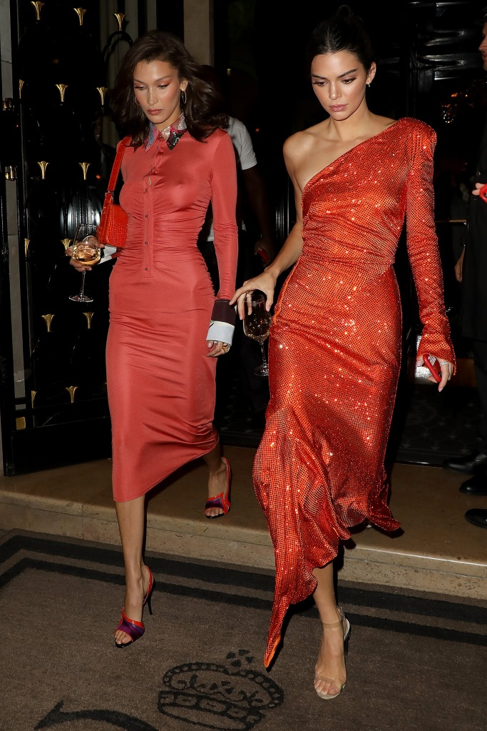 gettyimages 1045036600 Bella Hadid, Kendall Jenner and Rosie Huntington Whiteley Stepped Out in Matching Red Orange Dresses