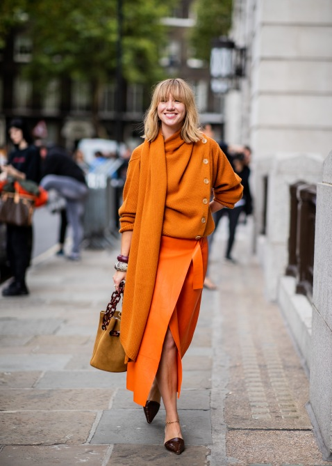 gettyimages 1033931358 3 Ways to Wear Fashion Month's Favorite Orange Sweater
