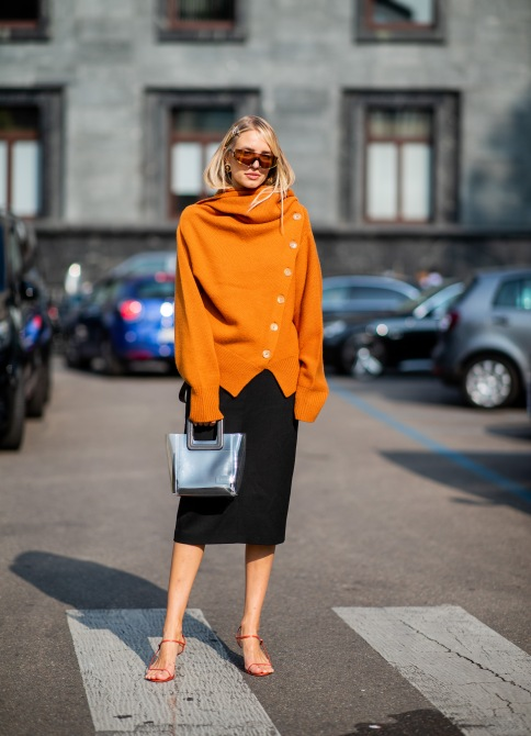 gettyimages 1036790956 3 Ways to Wear Fashion Month's Favorite Orange Sweater